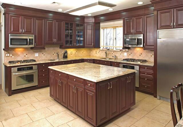 Dark red cherry kitchen cabinets for Cherry kitchen cabinets with black granite